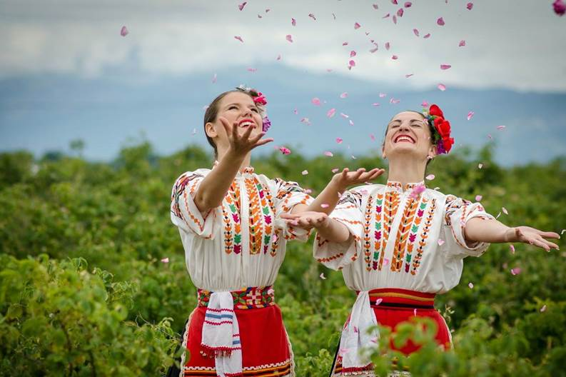 In the Plovdiv Valley traditionally dressed women play with rose petals